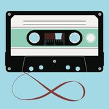 Vector audio cassette. Vector audio cassette with plastic tape in a opaque case isolated on blue background vector illustration