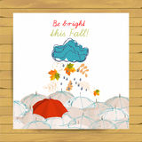 Vector autumn doodles card. Hand draw umbrellas and leafs over watercolor paper. Lettering quote. Season of the rain, greeting car Stock Images