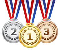 Vector award medals set. Set of gold, silver and bronze medal with tricolor ribbon on white background, vector Royalty Free Stock Images