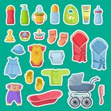 Vector baby accessories stickers  on blue background. Illustration of sticker carriage and pacifier, diaper and clothing Stock Image