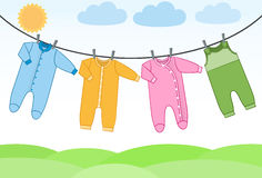 Vector baby clothes on clothesline. Royalty Free Stock Photography
