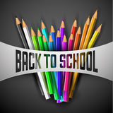 Vector Back to school poster. Colorful crayons on dark paper Royalty Free Stock Image