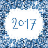 Vector background with blue snowflakes and text 2017. On the theme of new year, christmas, winter. Abstract winter background with snowflakes frame. Vector stock illustration