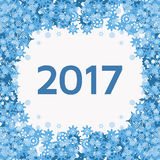 Vector background with blue snowflakes and text 2017. On the theme of new year, christmas, winter. Abstract winter background with snowflakes frame. Vector vector illustration