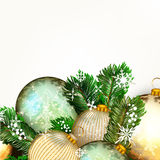 Vector background with golden baubles and Xmas tree green branch Royalty Free Stock Image