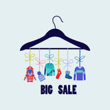 Vector Background of Hanger with fashion winter clothing Stock Image