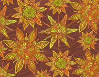 Vector background with ornament of the graphic suns. Royalty Free Stock Image