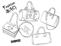 Vector sketch. Set of bags. Vector background. Vector sketch. Set of bags. Illustration. Fashion sketch Stock Photos