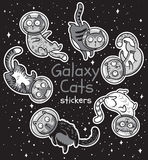 Vector badge with cats astronauts. Stickers kit. Sticker set of cats astronauts in galaxy. Funny vector childish patches. Pets explore the cosmic world Royalty Free Stock Image