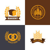 Vector bakery and bread shop logos labels badges with wheat ears royalty free illustration