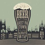 Glass of beer on the background of old town Stock Images