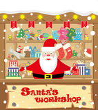 Vector banner Santa's workshop wih Santa Claus and gifts, toys, dolls, present box and lamp garlands with flags royalty free illustration