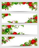 Vector banners with red, silver and green Christmas decorations. Royalty Free Stock Images