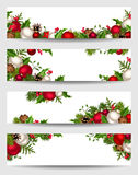 Vector banners with red, white and green Christmas decorations. Vector set of Christmas banners with red, white and green fir branches, balls, holly, mistletoe Royalty Free Stock Photo