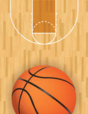 Vector Basketball and Hardwood Court. A realistic vector hardwood textured basketball court with basketball at the bottom. EPS 10. File contains transparencies Royalty Free Stock Photo
