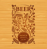 Vector beer emblem with hops and malt Stock Images
