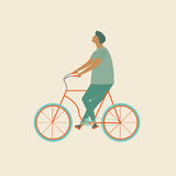 Vector bicycle rider. Funny cartoon character young man riding a bike. Royalty Free Stock Photography