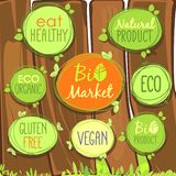 Vector Bio icon set on a wooden fence of labels, stamps or stickers with signs - Bio market, gluten free, organic product, vegan, stock illustration