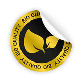 Vector bio quality bent sticker. Vector gold bent sticker with symbol of bio quality Stock Photos