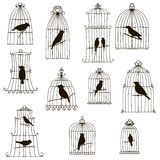 Vector birds in cages silhouettes Royalty Free Stock Photos