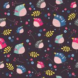 Vector birds and plants seamless pattern on a black background. Stock Photography