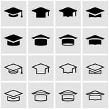 Vector black academic cap icon set. On grey background Royalty Free Stock Images