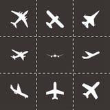 Vector black airplane icon set. Black background Stock Photography