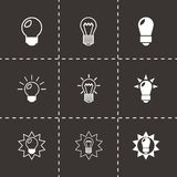 Vector black bulbs icon set. On black background Royalty Free Stock Image