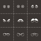 Vector black cartoon eyes icons set. On black background Royalty Free Stock Images