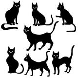 Vector black cat silhouettes. Vector set of black cat silhouettes, hand drawn animals isolated at white background stock illustration