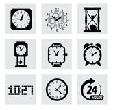 Vector black clocks icons Stock Images