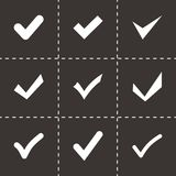 Vector black confirm icon set. On black background Royalty Free Stock Image