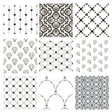 Vector Black Decorative Seamless Patterns Set. Set of 9 Black Decorative Seamless Background Patterns with Dots, Arabesque Ornaments and Diamonds. Vector Royalty Free Stock Image