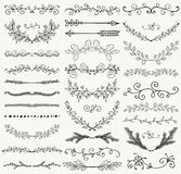 Vector Black Hand Drawn Dividers, Branches, Swirls. Set of Hand Drawn Black Doodle Design Elements. Decorative Floral Dividers, Arrows, Swirls, Laurels and Stock Image