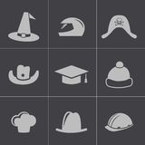 Vector black helmet and hat icons set Royalty Free Stock Image