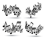 Vector black jolly wavy staves with musical notes Stock Images