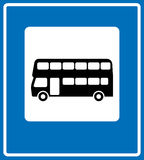 Vector black London bus icon on white background. Vector black silhouette London double-decker bus icon in white square isolated on blue background. Vector stop stock illustration