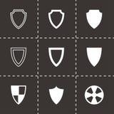 Vector black shield icon set. On black background Stock Photo