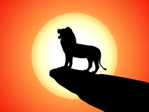 Vector black silhouette snarling lion on a rock Stock Images