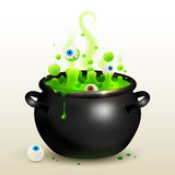 Vector black witches cauldron with green potion Royalty Free Stock Photos