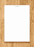 Vector blank paper A4 sheet on wooden background. Stock Image
