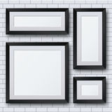 Vector blank picture frame set on brick wall Stock Photo