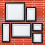 Vector blank picture frame set on brick wall Royalty Free Stock Image