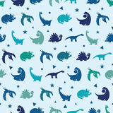 Vector Blue Dinosaurs Silhouettes Seamless Pattern Stock Photos