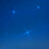 Vector blue evening skyes with stars Stock Image