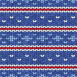 Vector blue knitted seamless pattern with red and white ornament Stock Photography