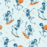 Vector blue and orange dancing and skateboarding skeletons Haloween repeat pattern background. Great for spooky fun. Party themed fabric, gifts, giftwrap Royalty Free Stock Images