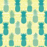 Vector blue yellow tribal pineapples vector background seamless repeat pattern. Summer colorful tropical textile print. Stock Photography