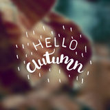 Vector blurred autumn landscape background with typography text Hello Autumn . Hand lettering poster. Stock Photos