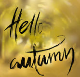 Vector blurred autumn landscape background with typography text. Hello Autumn. Stock Photography